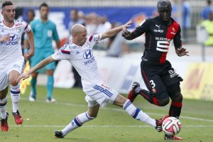 Olympique Lyon's Christophe Jallet challenges Cheikh M'Bengue (R) of Stade Rennes during their French Ligue 1 soccer match at the Gerland stadium in Lyon August 10, 2014.  REUTERS/Robert Pratta (FRANCE - Tags: SPORT SOCCER)